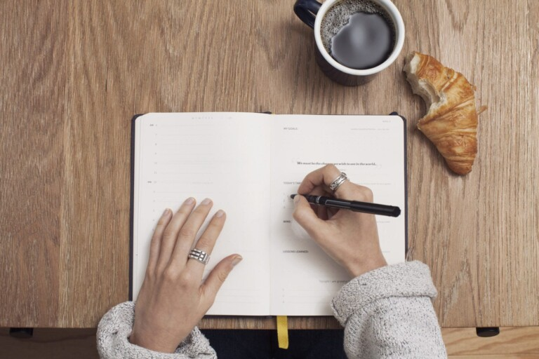 writing on notebook