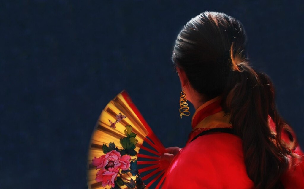 woman holding chinese fan