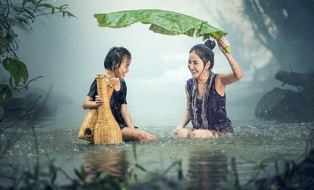 woman and child under rain