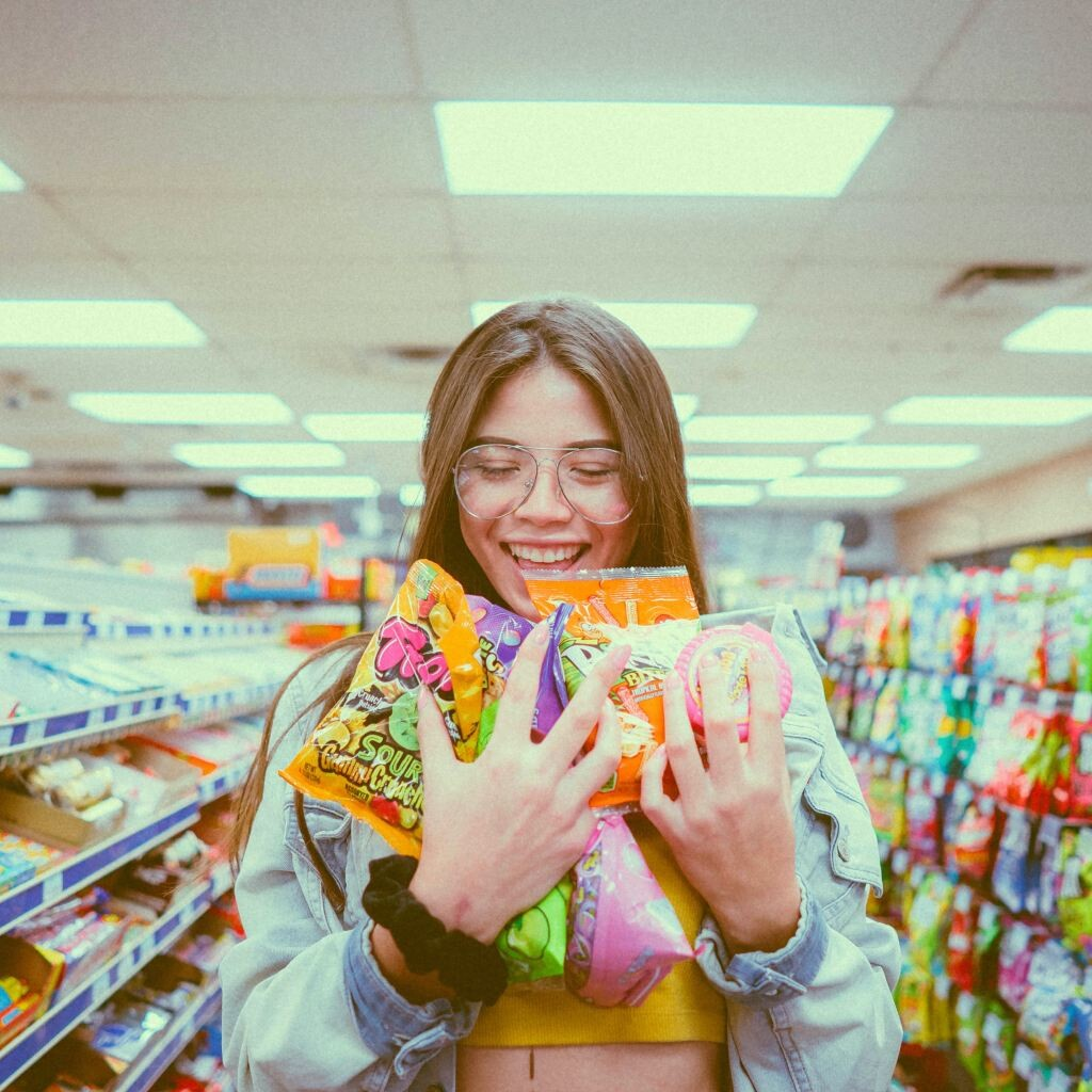 girl holding candies inside store